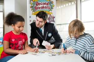 Pledging photo, Reading Agency Summer Challenge 2015 © Dave Warren Picture Team 2015 for The Reading Agency and with thanks to Southwark Libraries, Canada Water Library and the children from Alfred Salter Primary School